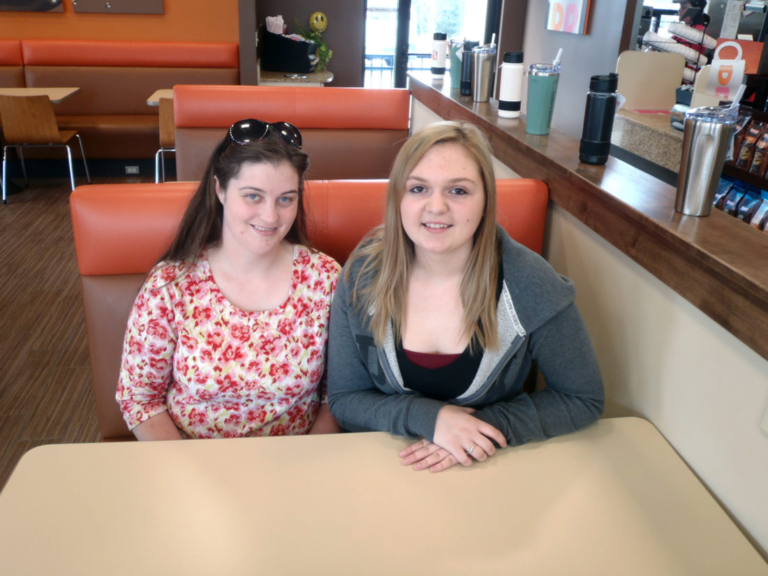Morning Journal/Tom Giambroni Dunkin' Donuts employees Danielle Hastings (left) and Megan Schriner came to the rescue of one of their regular customers.