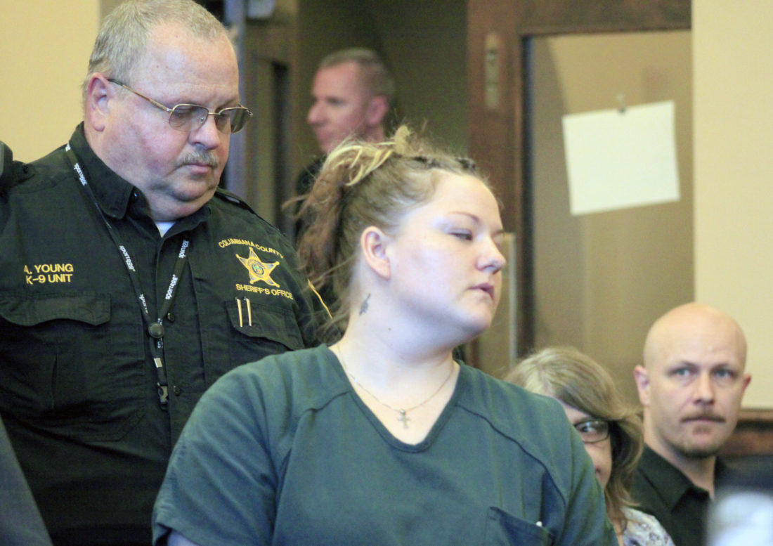 Morning Journal/Deanne Johnson Danielle Heckathorn is led into the courtroom by sheriff's Deputy Lt. Allan Young.