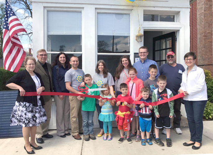 Submitted photo Attending the ribbon cutting for Energy Optimism were (from left) Carol Cobbs, chamber director; Rick Noel, councilman; Jen Colella, tourism bureau; Charles Hatch, owner; Jonah Hatch; Talia Hatch; Kathryn Hatch; Heather Doyle; Nathan Doyle; Moriah Doyle; Ury Doyle; Elijah Doyle; Isaiah Doyle; Zeke Doyle; Mike Ritterspach; and Ginny Perkins, chamber president.