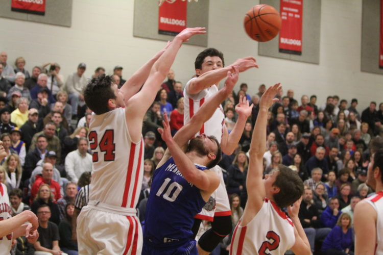 Staff photo by TOM KING Merrimack's Dan McKillop (10) fights Bedford's Nolan Anderson (24), Max Chartier and Connor Crowley (2) for a rebound during Friday night's Divison I quarterfinal in Bedford.