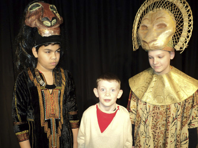"Photo courtesy of A. ROBERT DIONNE From left, Avery Cheeks as Scar, Ian Dolley as Young Simba, and Sawyer Broderick at Mufasa, in Majestic's production of ""Lion King Jr."""
