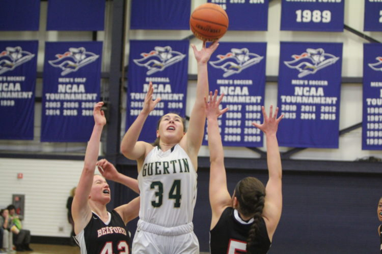 Staff photo by TOM KING Bishop Guertin's Meghan Cramb puts up a shot against the Bulldogs during Saturday's Division I final, presumed to be her last game as a high school athlete.