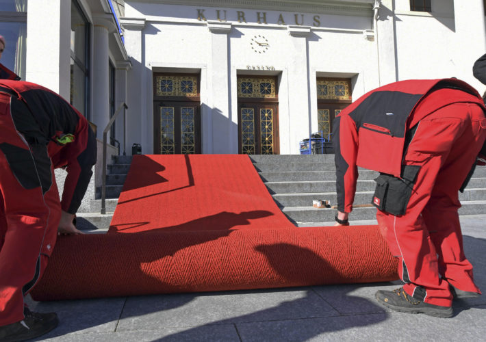 Employees roll out a red carpet during preparations for the G20  summit of finance ministers in Baden-Baden, southern Germany, Monday March 13, 2017.  The summit is scheduled for March 17 and March 18, 2017.  (Uli Deck/dpa via AP)