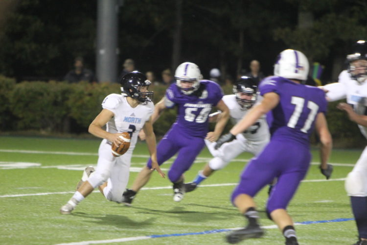 Staff file photo by TOM KING Nashua North QB Jeff Baldassari's skills as a runner as well as a passer helped him earn a spot on the New Hamsphire Shrine Team roster.
