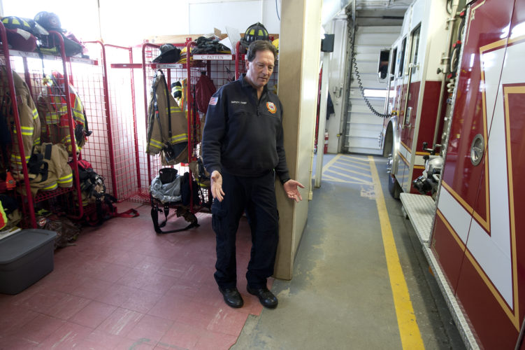 Staff photo by Don Himsel               Litchfield's deputy fire chief Doug Nicoll stands in the town's current fire station Wednesday. Voters approved spending $66,000 to revise current plans to build a new fire station on Liberty Way.