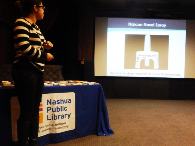 Staff photo by Derek Edry  Lisa Vasquez, substance misuse prevention coordinator for the Nashua Division of Public Health and Community Services, offers a tutorial March 23 at the Nashua Public Library on how to use Narcan, the opioid reversal drug.