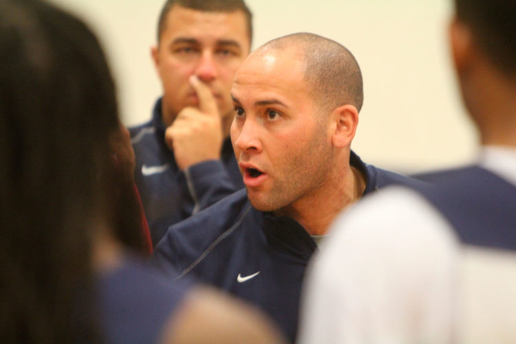 Staff file photo by TOM KING/Nashua North graduate Lance Bisson, the Rivier men's hoop head coach, is fighting an uphill battle to return the program back to the glory days of when he played for the Raiders 10 years ago.