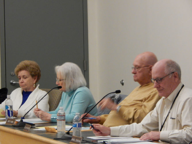 Staff photo by TINA FORBES From left, Board of Education members Sandra Ziehm, Dotty Oden, Bill Mosher and district financial officer Dan Donovan.