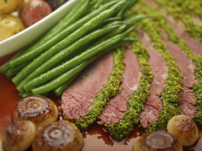 Photo by Phil Mansfield/The Culinary Institute of America via THE ASSOCIATED PRESS Shown is a red wine-braised brisket in a recipe by the CIA.