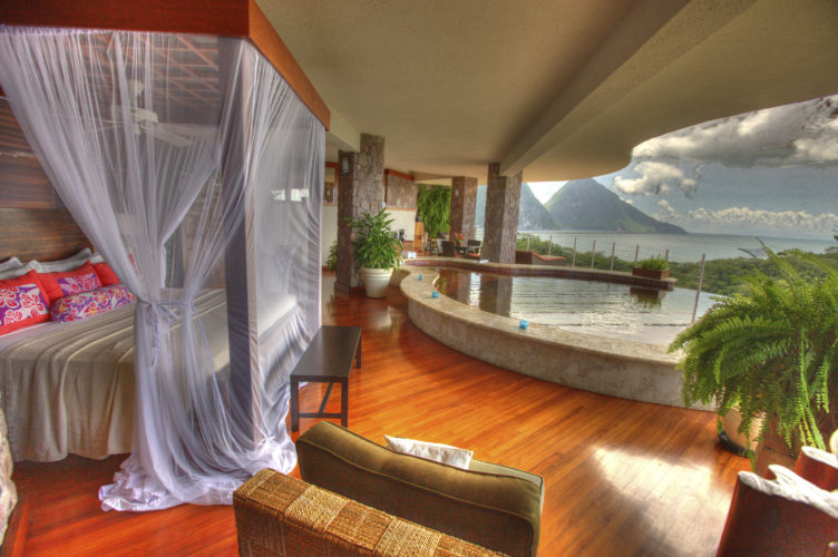 Photo courtesy of LOU METZGER Shown is a lavish open-air bedroom at Jade Mountain Resort on St. Lucia.