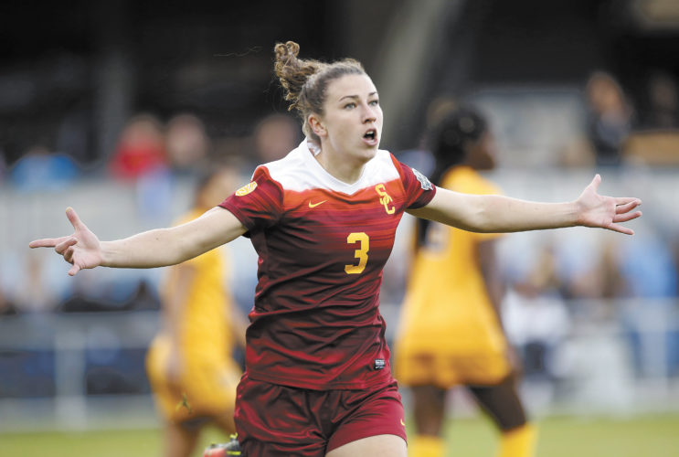 File photo by The Associated Press/Milford native Morgan Andrews celebrates after scoring a goal for the University of Southern California in the national championship in December. She is expected to make her professional debut with the Boston Breakers on Sunday.
