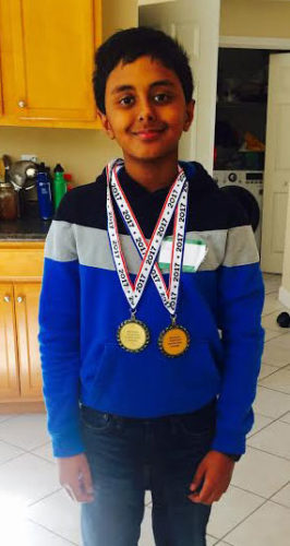 Courtesy photo Abhinav Avvaru proudly wears the medals he won at the recent Young Inventors New Hampshire Invention Convention.