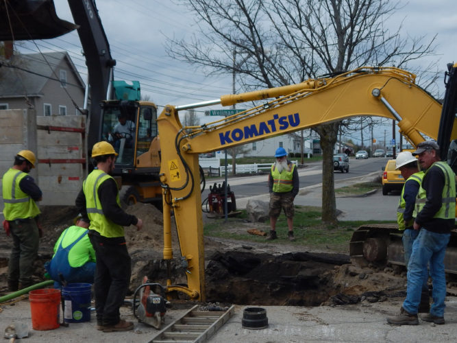 Staff photo by Derek Edry  A construction crew from Park Construction, of Fitzwilliam, replaces a water line in front of Amherst Street CITGO on April 19.