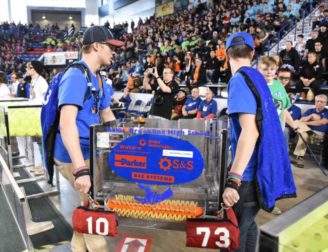 """Courtesy photo Hollis FIRST Robotics Team 1073 """"The Force"""" carries its robot """"Zeppelin"""" off the field during the 2017 New England District Championship at the University of New Hampshire in Durham."""