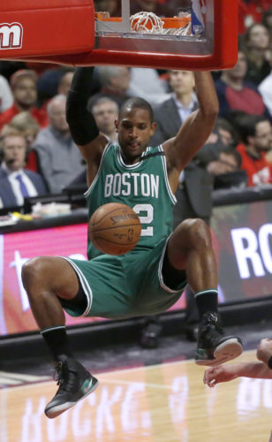 Boston Celtics' Al Horford dunks against the Chicago Bulls during the second half in Game 3 of an NBA basketball first-round playoff series in Chicago on Friday. (AP Photo/Charles Rex Arbogast)