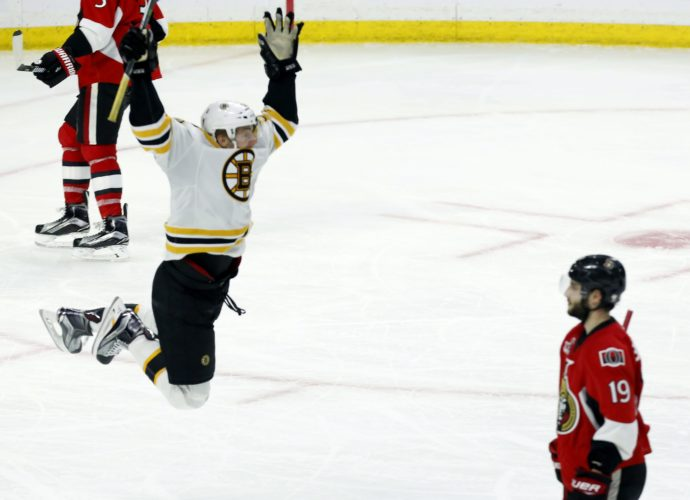 Ottawa Senators center Derick Brassard (19) watches as Boston Bruins center Sean Kuraly (52) celebrates his goal during the second overtime of Game 5 of a first-round NHL hockey Stanley Cup playoff series on Friday in Ottawa, Ontario. (Fred Chartrand/The Canadian Press via AP)