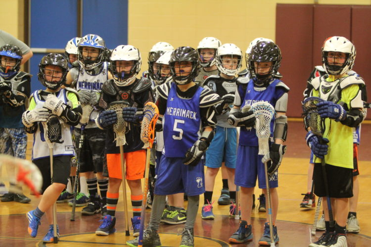 Staff photo by TOM KING/Lacrosse appears to be alive and well in Merrimack as several youths listen closely to instructions at a recent clinic.