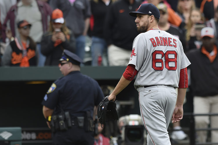 Boston Red Sox pitcher Matt Barnes walks off the field after being ejected for throwing at Manny Machado during the eighth inning of a baseball game Sunday in Baltimore. The Red Sox won 6-2. (AP Photo/Gail Burton)
