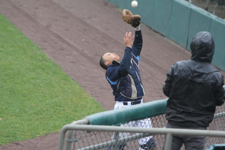 Staff photo by TOM KING Nashua North catcher Ruben Rodriguez was able to fight the raindrops to catch a foul pop in the first inning of Tuesday's suspended game with Merrimack.