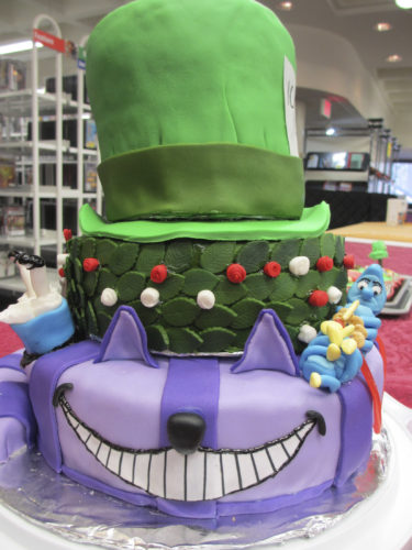 """Courtesy photo The Cheshire Cat from """"Alice in Wonderland"""" was a previous winner of the Edible Book Contest at the Nashua Public Library. This year's contest is from 1-4 p.m. Sunday."""