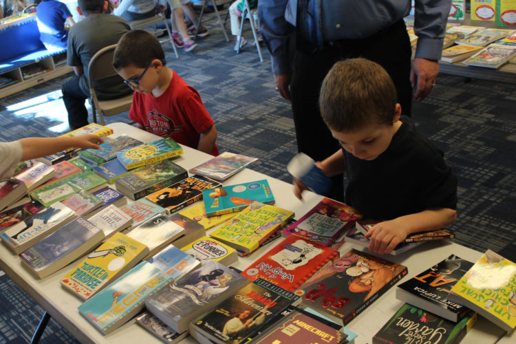 Courtesy photo Attendees at the YMCA's storytelling presentation got to choose two free books to take home.