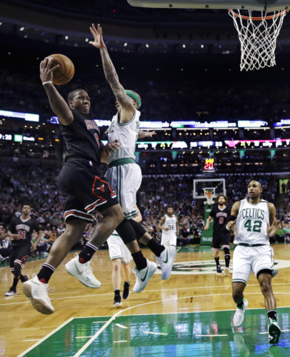 Chicago Bulls guard Isaiah Canaan, left, drives to the basket against Boston Celtics guard Isaiah Thomas (4) during the second quarter of a first-round NBA playoff basketball game in Boston, Wednesday, April 26, 2017. (AP Photo/Charles Krupa)