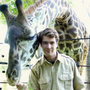 Courtesy photo The late Jonathan Gilmour, in whose name a scholarship fund was created following his death at age 29, was photographed in 2002 with Rafiki, a Masai giraffe, at the Franklin Park Zoo.