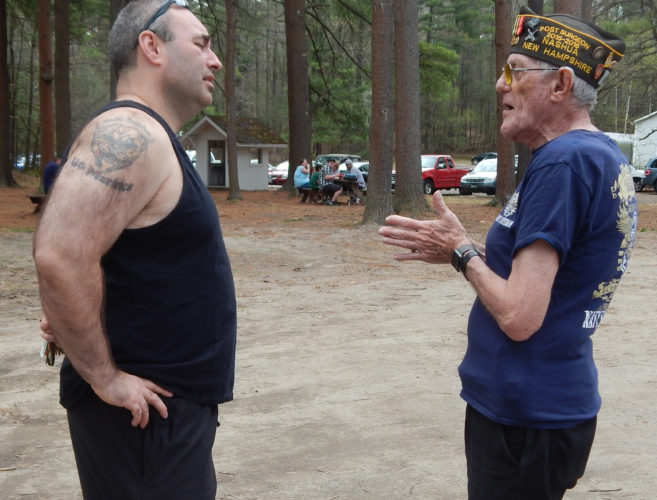 Staff photo by Derek Edry  Veterans James Cline (left) and Stephen Ribak share stories April 29 during the free Veterans Appreciation Day Picnic at the Hudson Fish and Game Club.