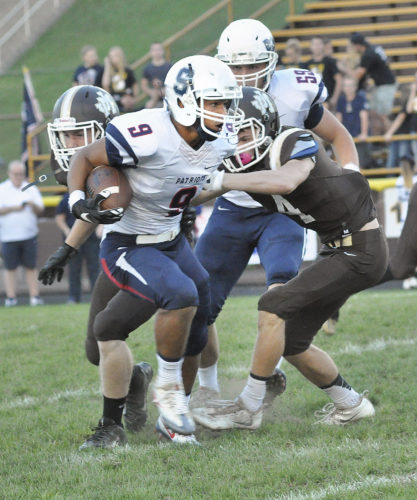 Photo by Andy Lloyd  Parkersburg South's Zane Hinzman breaks loose for one of his runs against the John Marshall defense during the Patriots' 44-12 win over the Monarchs.