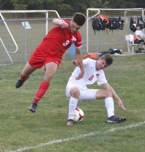 Photo by Ron Johnston Parkersburg's Parker Miller (3) battles Sean Fournier for control of the ball during a soccer game Saturday.