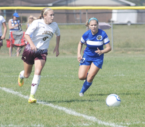 Photo by Steve Hemmelgarn Williamstown's Sydney Hill (left) looks to pass away from a Huntington St. Joseph player during a soccer game Saturday.