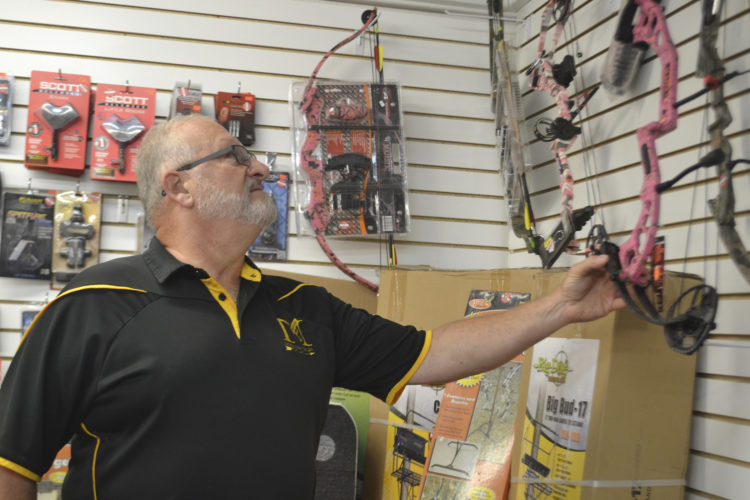 Photo by Breckin Wells Steve Pettebone, 67, of Marietta, checks out the archery gear at Magnum Get Your Shot On at 1259 Hartline Road in Whipple.