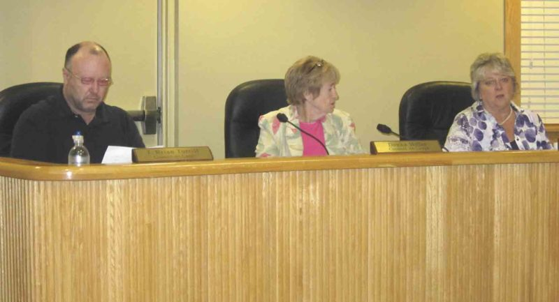 Photo by Wayne Towner Belpre City Council members, from left, Brian Turrill, Donna Miller and Susan Abdella talk during Monday's council meeting.