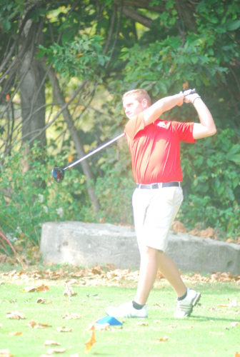 Photo by Joe Albright Parkersburg's Isaac Prine prepares to hit his first shot on No. 13 during the West Virginia Class AAA Region IV championship Monday at Greenhills Golf Club in Ravenswood. The Big Reds' golfer went on to par the hole and claimed medalist honors after shooting a 73 to help his team advance to the state championship.