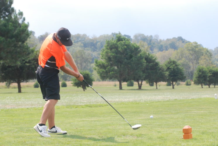 Photo by Matthew Hale Wirt County's Alex Sears tees off during a Class A regional golf match Monday at Mingo Bottom Country Club in Elizabeth.