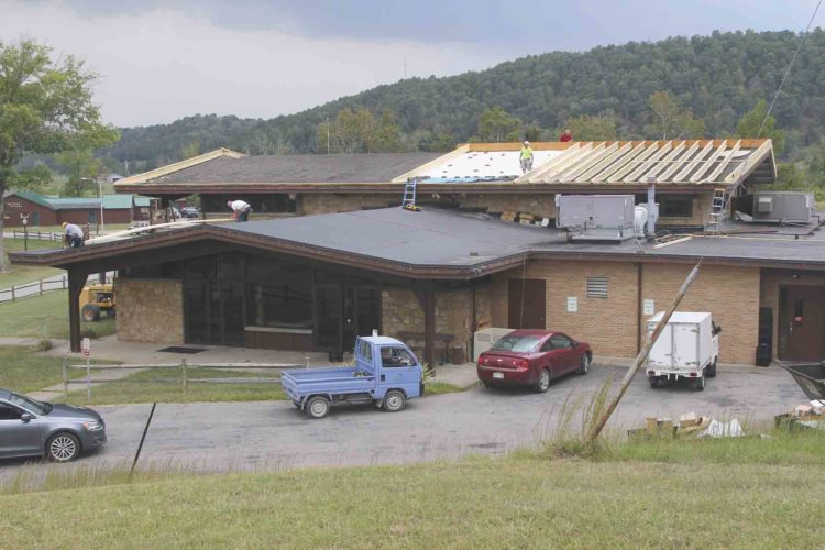 Photo Provided Crews at Cedar Lakes Conference Center work on the roof of the dining hall. The West Virginia Department of Agriculture took control of the facility in July and hopes to develop the property as a teaching location for its new practical agriculture program.
