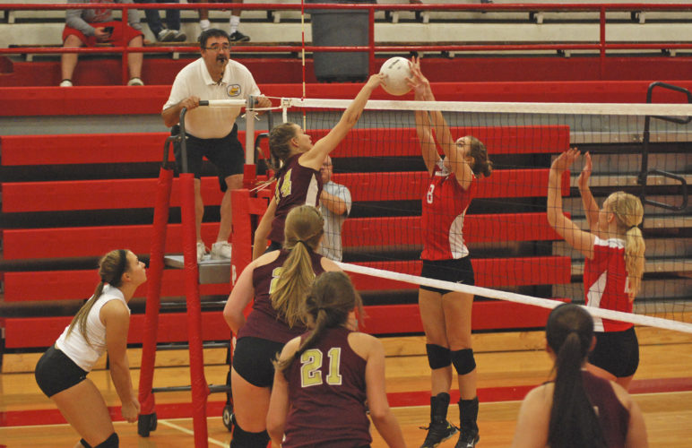 Photo by Jay W. Bennett Williamstown's Courtney Dotson just beats the single block from Parkersburg's Ciara Miller to register a kill during Tuesday night's triangular inside Memorial Fieldhouse.