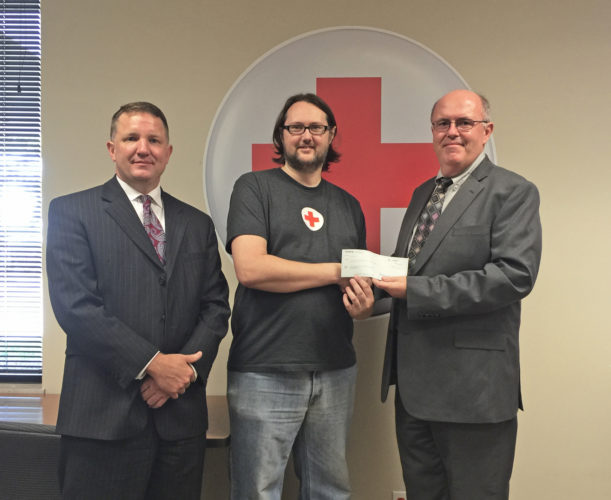 Photo Provided Checks were presented to the West Virginia Region of the American Red Cross and the West Virginia Voluntary Organizations Active in Disaster for flood relief in West Virginia totaling $15,668. From left, Craig Dean, vice president and senior trust officer at Peoples Bank; Scott Smith, senior disaster program manager for the American Red Cross in West Virginia, and Gregory Ullman, Peoples Bank senior vice president for Commercial Banking.