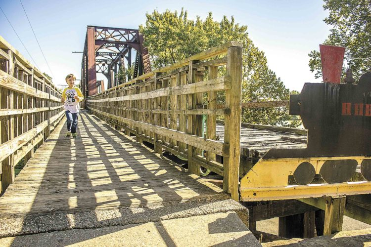 Photo by Janelle Patterson Matthew Cross, 5, of Belmont, runs across the Harmar Railroad Bridge Wednesday in Marietta.