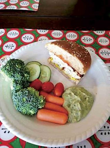 Photo Provided Lemon Thyme Chicken Burgers with a side of fresh veggies and guacamole is one of the possible meals that people can learn to cook at the Dining With Diabetes cooking classes being offered through the West Virginia University Extension Service.