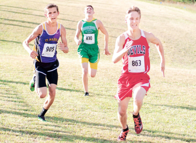 Photo by Jay W. Bennett Ravenswood's Bryce Jarrell, St. Marys' Walker Hashman and Doddridge County's Hunter Riffle near the finish line during last week's Little Kanawha Conference championship in Ritchie County.