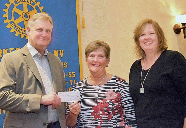 Rotary Club Drug Free Schools coordinator Bob Newell accepts a check of $1,175 from Parkersburg High School Foundation President Mary Ellen Manzo as Rotary President-Elect Jill Parsons looks on. The money will be used for the Drug Free Schools program. (Photo Provided)