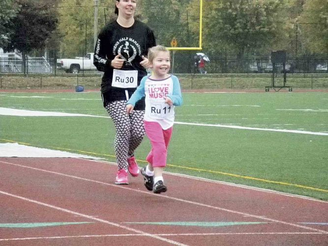 Grace Menzel ran her way to the finish line during a past Mole Day 6K Fun Run and Walk. (Photo provided by Michelle Jeitler)
