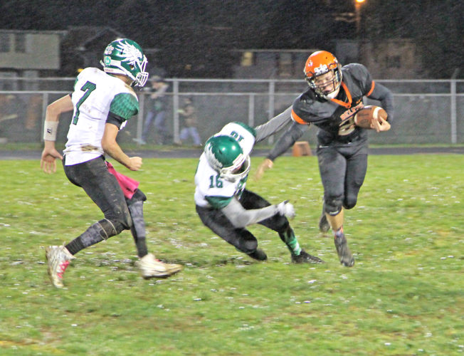Belpre running back Isaac Tullius is dragged down by Eastern's Nate Durst in the first quarter of the Golden Eagles' 25-20 victory at Ralph Holder Stadium Friday night. Photo by Tom Perry.