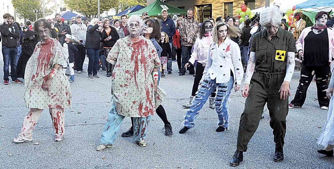A Thriller flash mob opened the fifth annual Monster Mash sponsored by Downtown PKB on the 400 block of Market Street on Saturday. (Photo by Jeffrey Saulton)