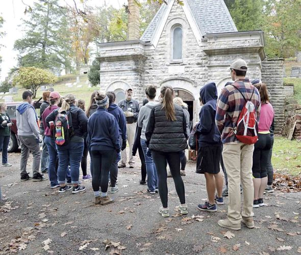 Marietta City Councilman Roger Kalter gives instructions to a group of volunteers in front of the chapel in Oak Grove Cemetery.  (Photo by Doug Loyer)