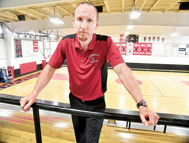 Ravenswood Athletic Director Chris Michael stands in the school's gymnasium. Michael said any event at Ravenswood which features Ripley as an opponent is worth numerous times more in revenue than any other school the Red Devils play. Photos by Jeff Baughan