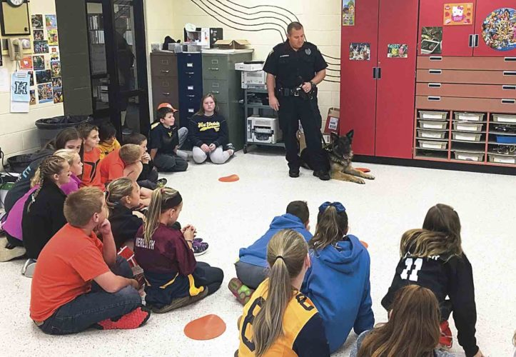 Parkersburg Police Patrolman J.N. Dennison with K9 Cedric spoke to students Tuesday at Mineral Wells Elementary School as part of an annual drug awareness program. (Photo by Michael Erb)