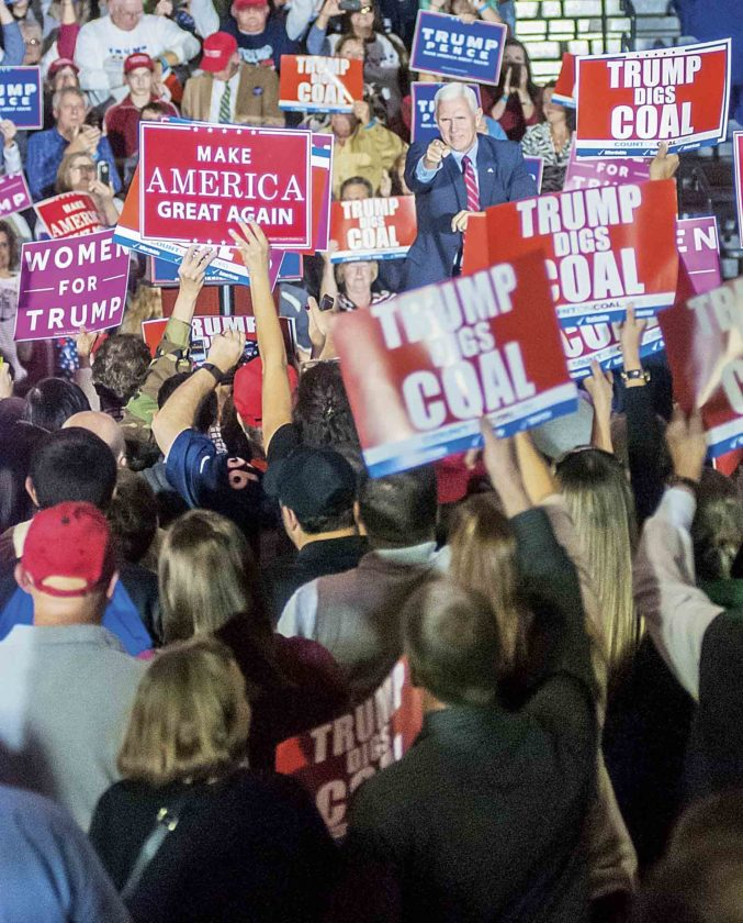 Gov. Mike Pence, of Indiana, points out to the crowd gathered in Marietta High School's gymnasium Tuesday during a rally for the Trump-Pence presidential ticket. (Photo by Janelle Patterson)