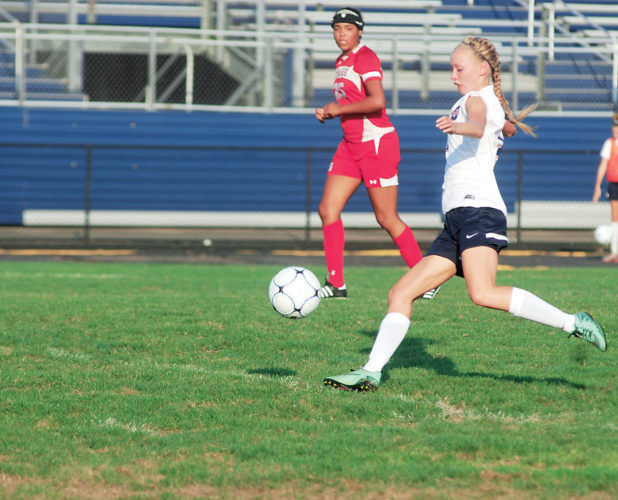 Photo by Jay W. Bennett Parkersburg South's Katie Husk brings the ball down the field during her team's 2-0 win over Wheeling Park earlier this season. Husk and company will be in action today when they take on Cabell Midland with a chance to go to the state tournament on the line.